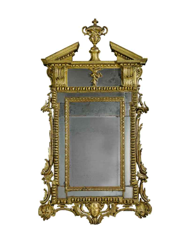 A Carved Giltwood Wall Mirror ...