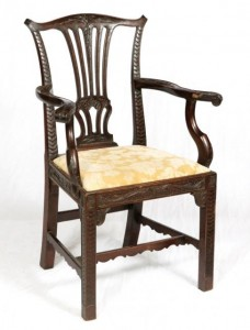 A GEORGIAN MAHOGANY CHIPPENDALE STYLE ARMCHAIR (250-350).