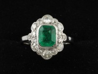 An antiques diamond and emerald cluster ring mounted in platinum (1,000-1,400).