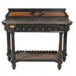 AN AESTHETIC MOVEMENT EBONISED AND STAINED OAK SIDE TABLE, by Lamb of Manchester, (200-400).