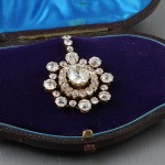 A diamond cluster pendant set with old cut stones.