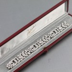 A c1940's diamond plaque bracelet (20,000-22,000).