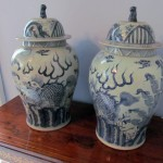 A pair of Oriental vases with original covers (250-350).