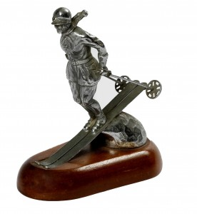 A nickel plated car mascot stamped Riley Ski Lady  (150-250).
