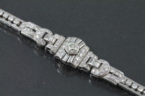 A 1930's diamond bracelet of circular design (17,000-18,000).
