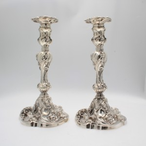 A pair of Rococo Silver candelsticks Dublin 1750 by R.Williams priced 25,000 at Weldons.