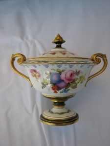 A Royal Crown Derby urn painted by Cuthbert Greasley c1913 at Brian Hurley's stand is priced at 550.