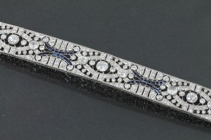 DIAMOND AND SAPPHIRE PANEL BRACELET, c. 1915 (20,000-22,000).