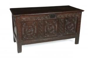 An 18th century oak chest (650-850).