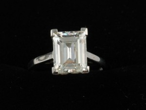 An emerald cut diamond solitaire (30,000-32,000)