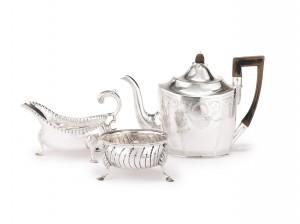 An Irish silver teapot, sauce boat, and sugar bowl, Cork, circa 1780-1800