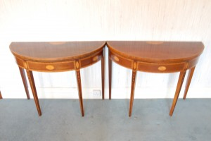 A pair of inlaid mahogany demi-lune card tables (2,000-3,000).