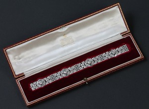An Art Deco diamond bracelet in original Garrard box (12,000-14,000).