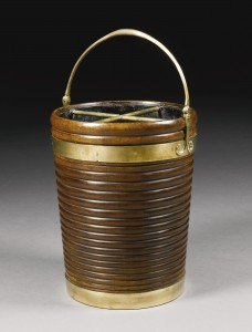 An Irish George III brass mounted peat bucket (£3,000-5,000).