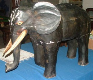 This vintage wooden elephant is estimated at 350-500.