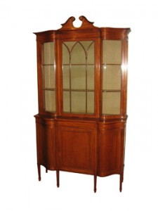 A satinwood display cabinet by Maple and Co.  (3,000-5,000)
