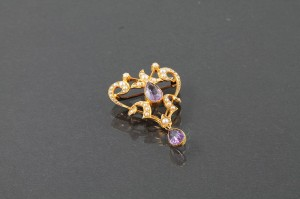 A VICTORIAN AMETHYST AND SEED PEARL BROOCH, c. 1890 (250-350)