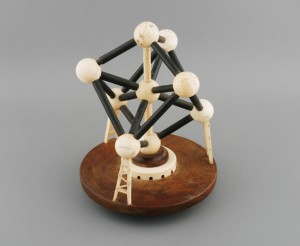 An ivory and ebony model of the  Atomium, Brussels (1,000-1,500).