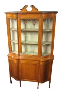 An early 20th Maples satinwood display cabinet (3,500-4,500).