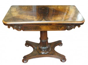 An early 19th century rosewood card table (1,600-2,500)