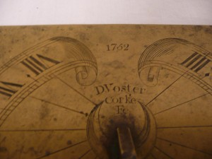 A detail of the sundial with the makers name and date.