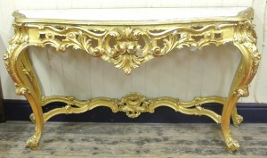 Louis XV style serpentine fronted gilt console table with shaped marble inset (1,400-2,000).