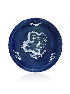 This rare foliate rim Yuan Dynasty (1279-1368) dish was sold to a Chinese collector.