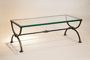 "Diego Giacometti (1902-1985)  Coffee-table in ""X"" shaped, second version  Bronze with brown and green patina at L'Arc en Seine."