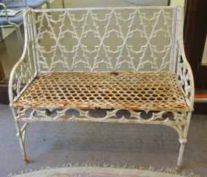 One of a pair of cast iron garden seats (1,000-2,0000.