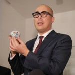 Nicolas Chow, Deputy Chairman of Sotheby's Asia and International Head of Chinese Ceramics and Works of Art, presents the Meiyintang Chicken Cup