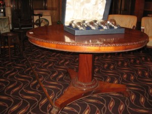 This Irish mahogany cross banded circular library table made 1,400.