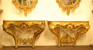 Pair of 19th century gilt wood console tables, one with marble top.