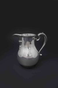 AN IRISH GEORGE II SILVER BEER JUG (5,000-6,000)
