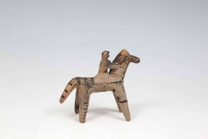 A GREEK BOEOTIAN SIXTH CENTURY B.C. TERRACOTTA MODEL OF A HORSE AND RIDER, decorated with dark brown painted stripes and spots. 10cm high Provenance: -Collection of Sir Clifford Norton (British Ambassador to Greece, stationed in Athens from 1946-1951)  (600-1,000)