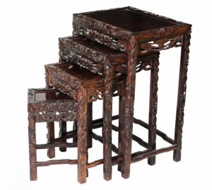 A carved Oriental nest of four tables (400-600).