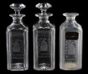 A set of three Bushmills cut and engraved spirit decanters (£300-500).