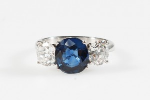 A FINE QUALITY DIAMOND AND SAPPHIRE THREE STONE RING, the oval sapphire to two brilliant cut diamonds, mounted in white gold. Together with coloured gemstone report stating the sapphire to be; 3.90 ct, of Burmese origin with no evidence of heat treatment  (18,000-22,000)