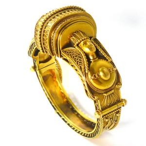 Yellow gold Egyptian Revival bangle, circa 1870, attributed to Carlo Giuliano at Cobwebs.