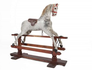 A LATE 19TH CENTURY DAPPLED GREY ROCKING HORSE (1,000-1,500)