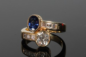 A diamond and sapphire cross over ring (6,000-7,000)
