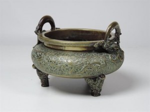A large Chinese bronze censer with dragon handles sold for 8,200 at hammer.