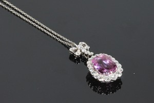 A pink diamond and sapphire cluster pendant (12,000-14,000).