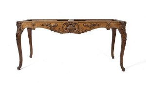 A French 19th century carved oak centre table with marble top (4,000-6,000).