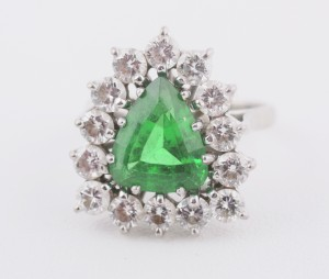 A large triangular emerald and diamond cluster ring (6,000-9,000).
