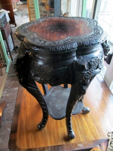 A Chinese hardwood stand with inset marble top.