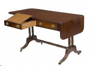 An Irish regency secretary sofa table (1,200-1,800).