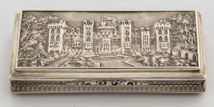 A snuff box chased with a view of Windsor Castle, Nathaniel Hills, Birmingham 1838 (1,500-2,200).