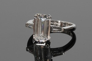 An emerald cut 3.31 carat F colour diamond solitaire ring (65,000-75,000).