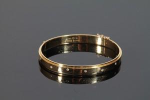 A Piaget diamond set bangle (2,400-2,800).
