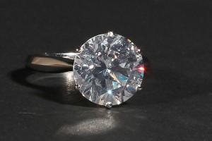 A 6.05 carat brilliant cut diamond solitaire ring (60,000-65,000).